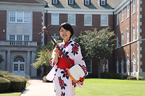 Japanese coordinator wearing a traditional kimono during a culture program in Arkansas