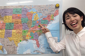 Cultural exchange program participant from Japan pointing at her host state Ohio on a map
