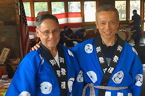 Friends from Japan and the U.S. wearing kimonos during a cultural exchange activity