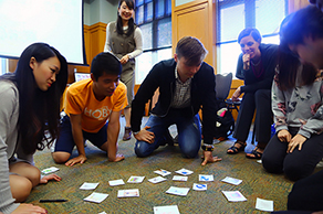 Japanese and Americans sharing their cultures through a card game